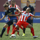 IMAGE DISTRIBUTED FOR GUINNESS INTERNATIONAL CHAMPIONS CUP - Manchester City midfielder David Silva (21) and Olympiacos midfielder Mathieu Dossevi, right, battle for the ball during the second half of 2014 Guinness International Champions Cup, on Saturday