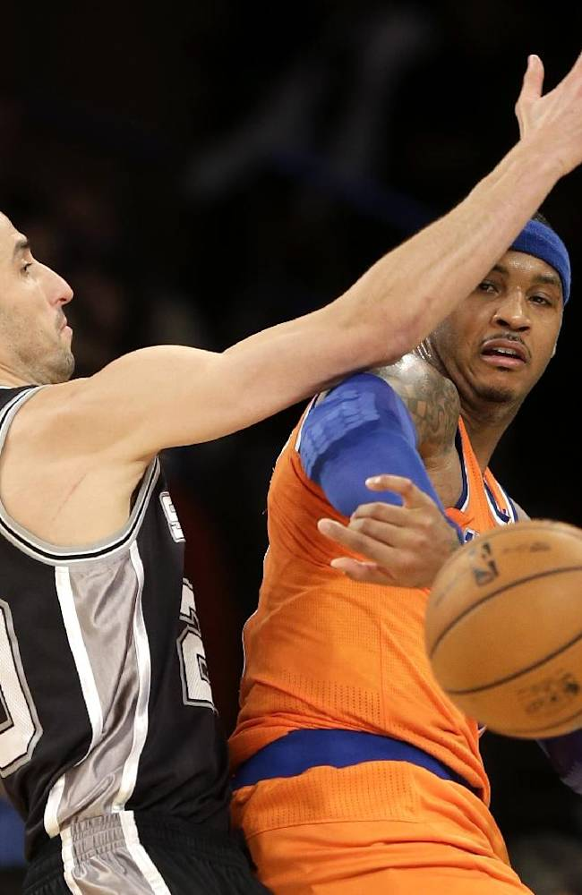 New York Knicks' Carmelo Anthony, right, passes around San Antonio Spurs' Manu Ginobili during the first half of an NBA basketball game at Madison Square Garden, Sunday, Nov. 10, 2013, in New York