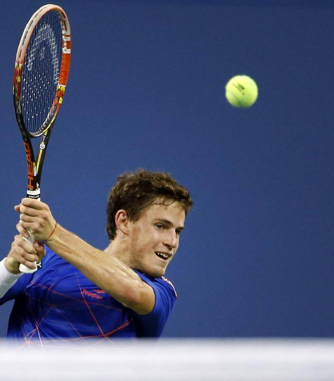 Diego Schwartzman, of Argentina, returns a shot to Novak Djokovic, of Serbia, during the opening round of the U.S. Open tennis tournament Monday, Aug. 25, 2014, in New York