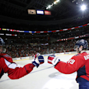 Washington Capitals center Nicklas Backstrom, right, from Sweden, celebrates his score in the shootout with right wing Alex Ovechkin, from Russia, during an NHL hockey game against the Minnesota Wild, Thursday, Nov. 7, 2013, in Washington. The Capitals wo