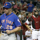 New York Mets' Daniel Murphy (28) shouts and pumps his fist after he scored a run as Arizona Diamondbacks' Miguel Montero (26) pauses at home plate during the third inning of a baseball game on Monday, April 14, 2014, in Phoenix The Associated Press