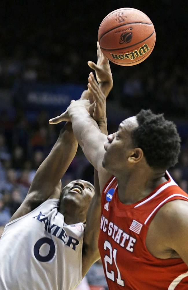 North Carolina State forward Beejay Anya (21) blocks a shot by Xavier guard Semaj Christon (0) during the first half of a first-round game of the NCAA college basketball tournament, Tuesday, March 18, 2014, in Dayton, Ohio