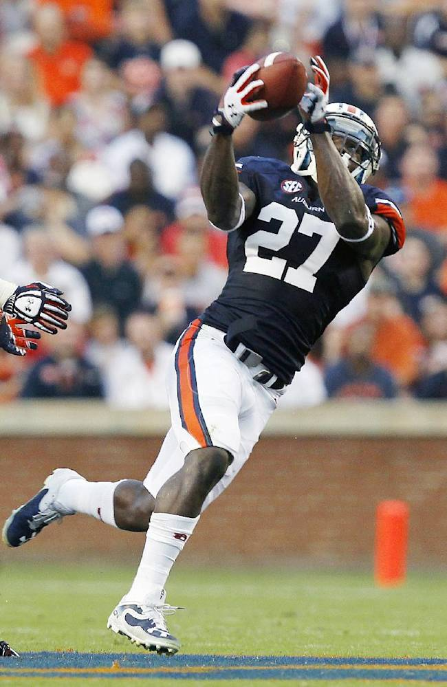FILE -- In this photo taken Aug. 21, 2013, Auburn Tigers defensive back Robenson Therezie (27) intercepts a pass during the first quarter of an NCAA college football game against Washington State. Therezie has gone from a forgotten man in Auburn's defense to one of the Tigers' biggest playmakers. Therezie has thrived in the Star role he took over only with a preseason injury to Justin Garrett