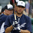 Detroit Tigers second baseman Ian Kinsler, center, waits his turn in the batting cage before an exhibition spring training baseball game between the Detroit Tigers and the Pittsburgh Pirates in Lakeland, Fla., Tuesday, March 4, 2014 The Associated Press