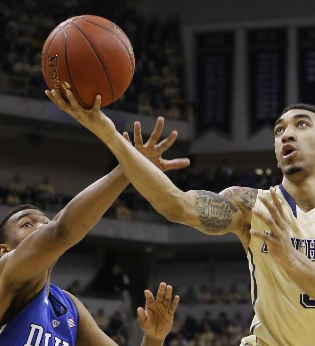 Pittsburgh's Cameron Wright, right, shoots past Duke's Jabari Parker during the first half of an NCAA college basketball game, Monday, Jan. 27, 2014, in Pittsburgh