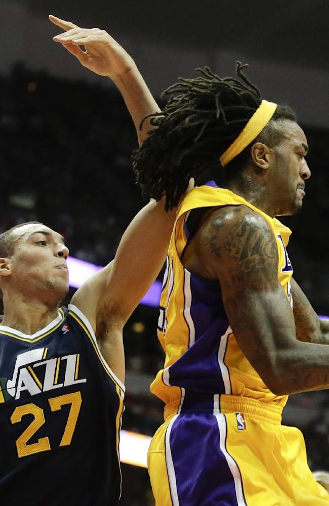 Los Angeles Lakers center Jordan Hill, right, pulls a rebound away from Utah Jazz center Rudy Gobert during the second half of a preseason NBA basketball game in Anaheim, Calif., Friday, Oct. 25, 2013. The Lakers won 111-106