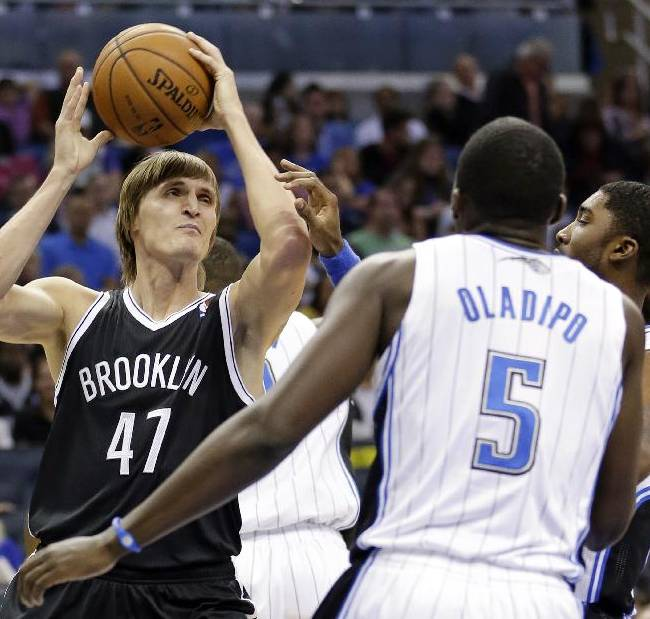 Brooklyn Nets' Andrei Kirilenko (47), of Russia, looks to pass the ball as he is defended by the Orlando Magic defense including Victor Oladipo (5) during the first half of an NBA basketball game in Orlando, Fla., Sunday, Nov. 3, 2013