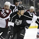 Los Angeles Kings' Jake Muzzin, right, skates past Colorado Avalanche's Jamie McGinn during the first period of an NHL hockey game on Saturday, Nov. 23, 2013, in Los Angeles The Associated Press