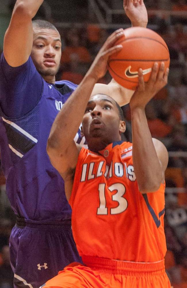 Illinois guard Tracy Abrams (13) attempts to shoot past Northwestern forward Mike Turner during the first half of an NCAA college basketball game on Thursday, Jan. 17, 2013, in Champaign, Ill
