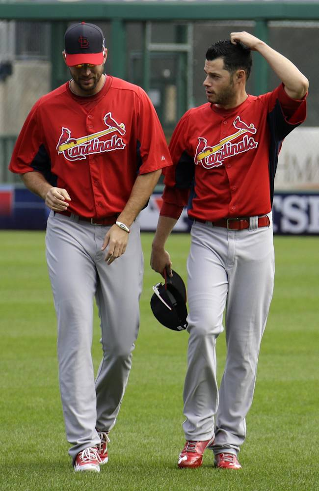 St. Louis Cardinals pitcher Joe Kelly, right, talks with pitcher Adam Wainwright while warming up in the outfield during a baseball workout in Pittsburgh, Saturday, Oct. 5, 2013. Kelly is scheduled to start Game 3 of the National League division series against the Pittsburgh Pirates on Sunday
