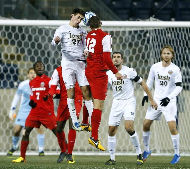 Notre Dame's Patrick Hodan (27) battles New Mexico's Kyle Venter (12) for a header in the second half during a semifinal match in theNCAA Division 1 men's soccer championships in Chester, Pa., Friday, Dec. 13, 2013. Notre Dame defeated New Mexico 2-0 to advance to Sunday's championship game