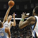 Memphis Grizzlies center Kosta Koufos (41) passes to teammate Tony Allen (9) over Denver Nuggets forward Darrell Arthur (00) and Jan Vesely, left, in the second half of an NBA basketball game Friday, April 4, 2014, in Memphis, Tenn. The Grizzlies won 100-