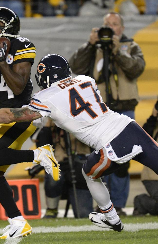 Pittsburgh Steelers wide receiver Antonio Brown (84) makes a catch in front of Chicago Bears free safety Chris Conte (47) in the second quarter of an NFL football game on Sunday, Sept. 22, 2013, in Pittsburgh