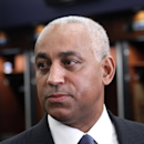 In this Oct. 4, 2010, file photo, Omar Minaya speaks to the media in the New York Mets clubhouse at Citi Field in New York. A person familiar with the decision says former New York Mets general manager Omar Minaya is leaving his job as senior vice pres