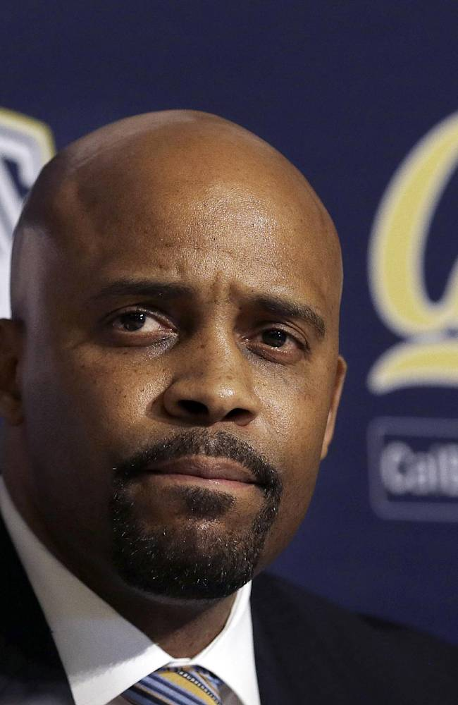 Cuonzo Martin sits at a news conference as he is introduced as the new men's basketball coach at California in Berkeley, Calif., Tuesday, April 15, 2014. California hired Tennessee's Cuonzo Martin as its coach Tuesday, charging him with taking over another program after a successful run by his predecessor. Martin replaces Mike Montgomery, who retired last month after six seasons in Berkeley