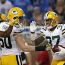 Green Bay Packers cornerback Sam Shields (37) celebrates his interception during the third quarter of an NFL football game against the Detroit Lions at Ford Field in Detroit, Thursday, Nov. 28, 2013 The Associated Press