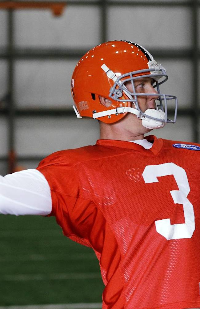 Cleveland Browns quarterback Brandon Weeden passes during NFL football practice at the team's facility in Berea, Ohio Wednesday, Oct. 16, 2013. Browns fans have been particularly tough on Weeden, who said the criticism is just part of being an NFL quarterback