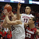 Arizona's Kaleb Tarczewski (35) and Nick Johnson (13) battle Stanford's Dwight Powell (33) for a rebound in the first half of an NCAA college basketball game, Sunday, March 2, 2014 in Tucson, Ariz. (AP Photo/John MIller)