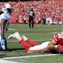 Kansas City Chiefs tight end Anthony Fasano (80) scores on a 5-yard touchdown reception in front of Tennessee Titans safety Michael Griffin in the second half of an NFL football game in Kansas City, Mo., Sunday, Sept. 7, 2014 The Associated Press