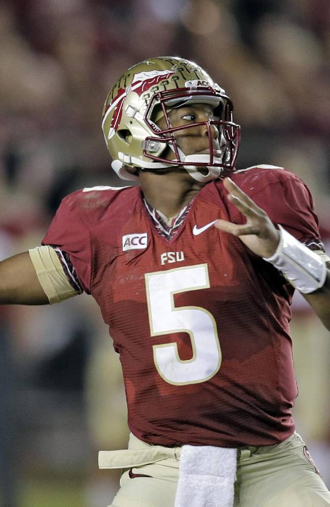 In this Nov. 2, 2013 file photo, Florida State quarterback Jameis Winston throws a pass during the third quarter of an NCAA college football game against Miami, in Tallahassee, Fla