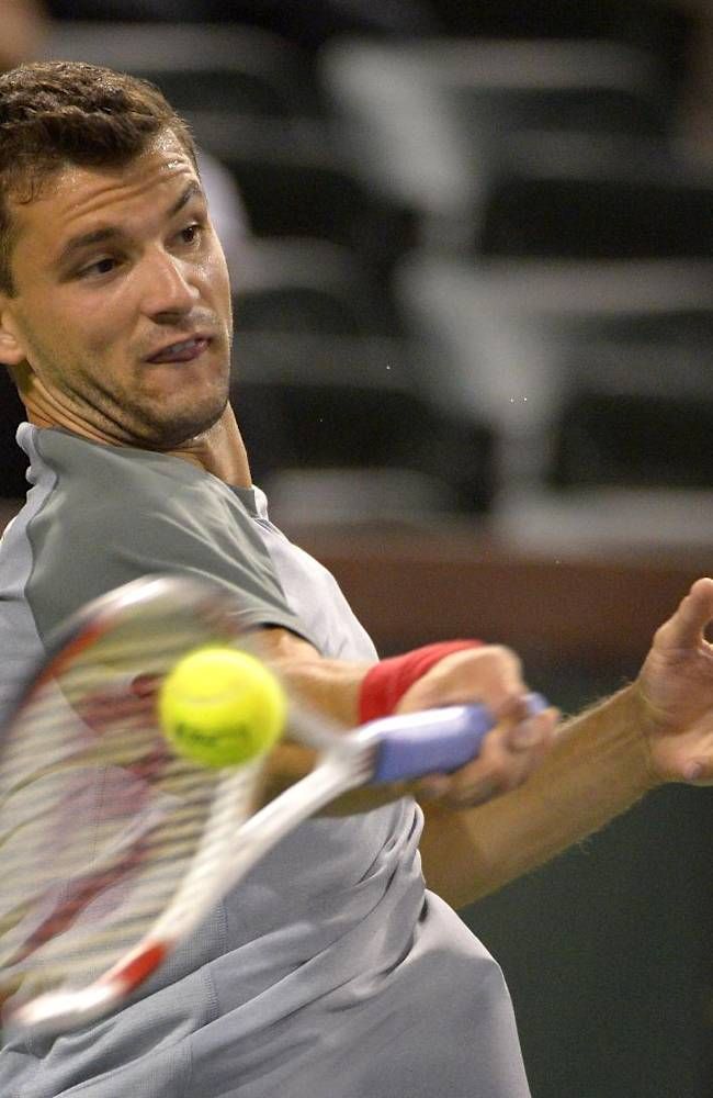Grigor Dimitrov, of Bulgaria, returns a shot to Robin Haase, of the Netherlands, during their match at the BNP Paribas Open tennis tournament, Sunday, March 9, 2014, in Indian Wells, Calif