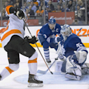 Toronto Maple Leafs goaltender Jonathan Bernier, right, stops Philadelphia Flyers' Mark Streit, left, during the third period of an NHL hockey game, Saturday, March 8, 2014 in Toronto The Associated Press