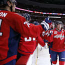 Washington Capitals center Nicklas Backstrom, right, from Sweden, celebrates his second goal in the second period of an NHL hockey game against the Tampa Bay Lightning, Saturday, Dec. 13, 2014, in Washington. Backstrom had a hat trick and the Capitals won