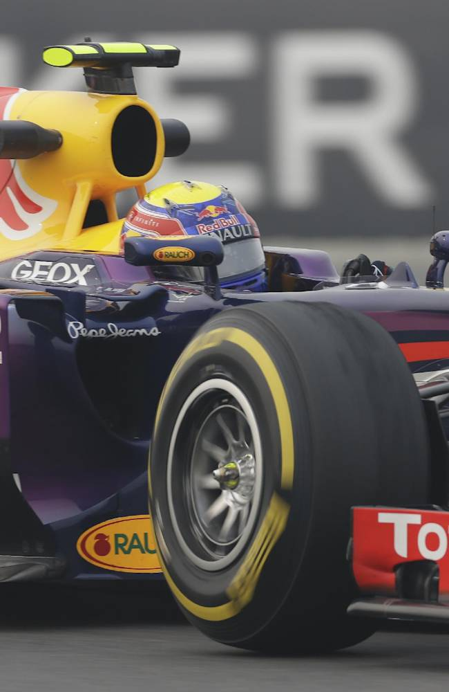 Red Bull driver Mark Webber of Australia steers his car during the second practice session at the Indian Formula One Grand Prix at the Buddh International Circuit in Noida, India, Friday, Oct. 25, 2013