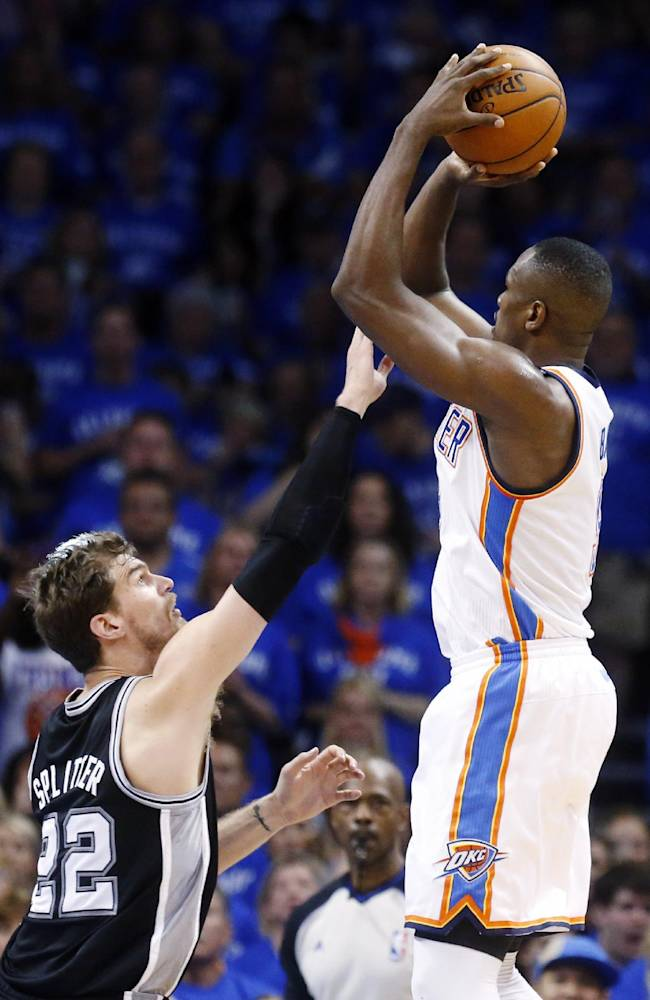 Oklahoma City Thunder forward Serge Ibaka, right, shoots over San Antonio Spurs center Tiago Splitter (22) in the third quarter of Game 3 of an NBA basketball playoff series in the Western Conference finals, Sunday, May 25, 2014, in Oklahoma City. Oklahoma City won 106-97
