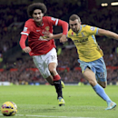 Manchester United's Marouane Fellaini, left, and Crystal Palace's James McArthur battle for the ball during their English Premier League match at Old Trafford, Manchester England Saturday Nov. 8, 2014