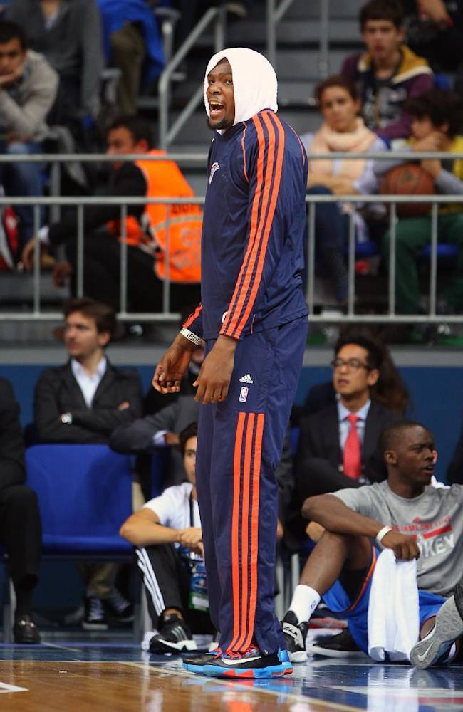 Oklahoma City Thunder's Kevin Durant gestures to playing teammates during a preseason basketball game in Istanbul, Turkey, Saturday, Oct. 5, 2-13Oklahoma City Thunder has opened the preseason schedule with a game against the five-time Turkish champions at the Ulker Sports Arena.  (AP Photo)