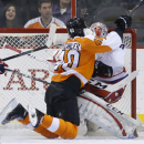 Philadelphia Flyers' Vincent Lecavalier, left, collides with Washington Capitals' Braden Holtby during the first period of an NHL hockey game, Wednesday, March 5, 2014, in Philadelphia The Associated Press
