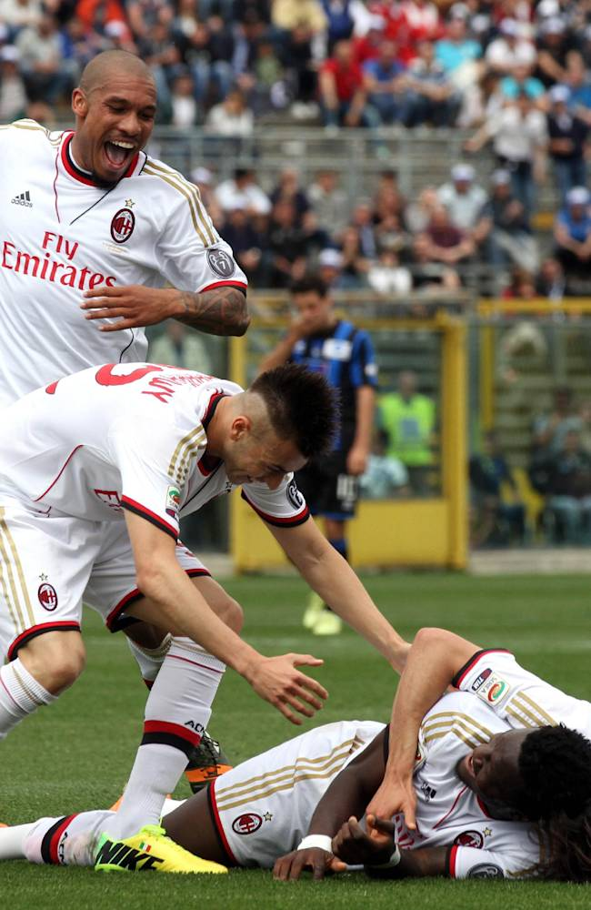 AC Milan's players celebrate after Atalanta's Giampaolo Bellini scored an own goal during a Serie A soccer match in Bergamo, Italy, Sunday, May 11, 2014