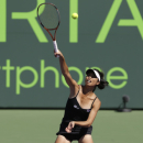 Hsieh Su-wei, of Taiwan, returns to Agnieszka Radwanska, Poland, during the Sony Open tennis tournament in Key Biscayne, Fla., , Thursday, March 21, 2013. (AP Photo/Alan Diaz)