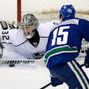 Los Angeles Kings goalie Jonathan Quick, left, stops a shot by Vancouver Canucks' Brad Richardson during the second period of an NHL hockey game Saturday, April 5, 2014, in Vancouver, British Columbia The Associated Press