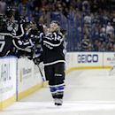 Tampa Bay Lightning's Ryan Callahan (24) celebrates his goal in a shootout as Colorado Avalanche goalie Semyon Varlamov, of Russia, reacts in the background during an NHL hockey game Saturday, Jan. 17, 2015, in Tampa, Fla. The Lightning won 3-2 The Associ