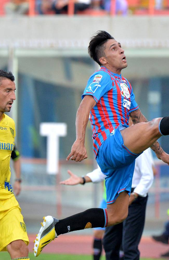 Catania's Lucas Castro, of Argentina, reaches for the ball during the Serie A soccer match between Catania and Chievo Verona at the Angelo Massimino stadium in Catania, Italy, Sunday, Sept. 29, 2013