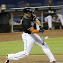 Miami Marlins' Giancarlo Stanton hits a double against the San Diego Padres in the seventh inning of a baseball game in Miami, Saturday, April 5, 2014. Christian Yelich scored on the double. The Marlins won 5-0 The Associated Press