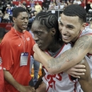 New Mexico's Kendall Williams, right, rides on the back of Tony Snell after New Mexi;co defeated UNLV 63-56 in an NCAA college basketball game for the Mountain West Conference men's tournament title, Saturday, March 16, 2013, in Las Vegas. (AP Photo/Isaac Brekken)