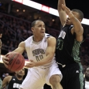 FILE - In this March 10, 2012 file photo, Akron's Alex Abreu (11) tries to get past Ohio's Reggie Keely (30) in the first half during an NCAA college basketball championship game in the Mid-American Conference men's tournament in Cleveland. Abreu, from Puerto Rico, plead not guilty to trafficking and possession of marijuana in Municipal Court on Friday, March 8, 2013, one day after he was arrested by police for allegedly accepting a package containing 5 pounds of marijuana. The junior has been suspended indefinitely from the Zips, who play their regular-season finale at home against Kent State on Friday. (AP Photo/Tony Dejak, File)
