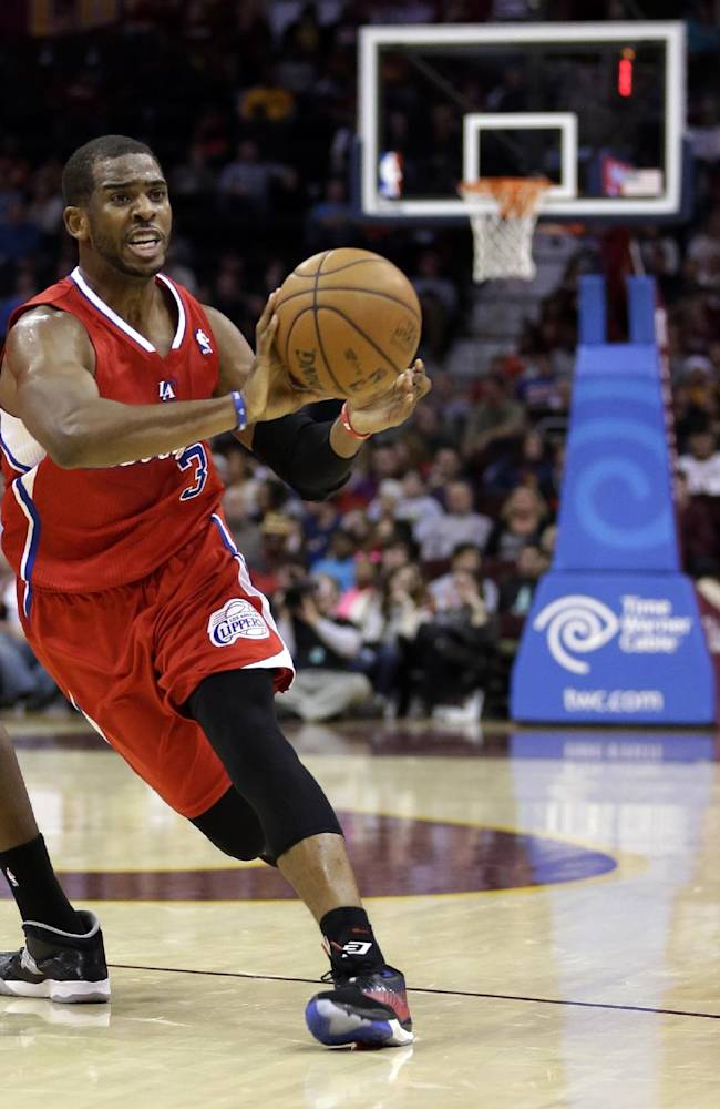In this Dec. 7, 2013, file photo, Los Angeles Clippers' Chris Paul passes the ball during an NBA basketball game against the Cleveland Cavaliers in Cleveland. Before Paul missed the month of January while recovering from a shoulder injury, he was averaging 19.6 points and a league-best 11.2 assists in 34 games