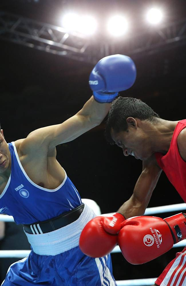 India's Devendro Laishram, left, throws a left jab at Sri Lanka's Madushan Gamage in the Men's light flyweight preliminaries bout at the Commonwealth Games Glasgow 2014, Glasgow, Scotland, Monday July 28, 2014