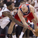 Toronto Raptors' Amir Johnson, left, and Washington Wizards' Marcin Gortat battle for the ball during second half NBA basketball action in Toronto, Thursday, Feb. 27, 2014 The Associated Press