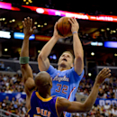 Los Angeles Clippers forward Blake Griffin (32) drives against Los Angeles Lakers guard Jodie Meeks (20) for a basket in the first half of an NBA basketball game on Sunday, April 6, 2014, in Los Angeles The Associated Press
