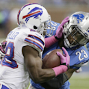 In this Oct. 5, 2014, file photo, Buffalo Bills running back C.J. Spiller (28) is stopped by Detroit Lions cornerback Darius Slay during the first quarter of an NFL football game in Detroit. Spiller is suddenly becoming the forgotten player in the Buffalo