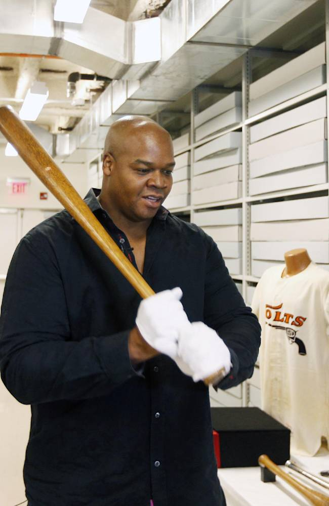 Former Chicago White Sox player Frank Thomas holds a Babe Ruth bat in the archives area during his orientation visit at the Baseball Hall of Fame on Monday, March 3, 2014, in Cooperstown, N.Y. Thomas will be inducted to the hall in July