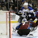 St. Louis Blues center David Backes, top, scores a goal against Colorado Avalanche goalie Semyon Varlamov, of Russia, bottom, in the second period of an NHL hockey game on Saturday, March 8, 2014, in Denver The Associated Press