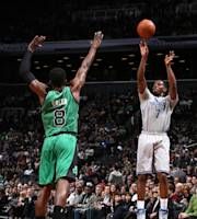 BROOKLYN, NY - MARCH 21: Joe Johnson #7 of the Brooklyn Nets shoots against Jeff Green #8 of the Boston Celtics during a game at the Barclays Center on March 21, 2014 in the Brooklyn borough of New York City. (Photo by Nathaniel S. Butler/NBAE via Getty Images)