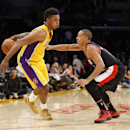 Los Angeles Lakers forward Nick Young dribbles behind his back as Portland Trail Blazers guard C.J. McCollum defends during the second half of an NBA basketball game in Los Angeles, Tuesday, April 1, 2014. The Trail Blazers won 124-112 The Associated Pres