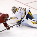 Nashville Predators' Pekka Rinne (35), of Finland, makes a kick save on a shot by Arizona Coyotes' Antoine Vermette (50) during the third period of an NHL hockey game Thursday, Dec. 11, 2014, in Glendale, Ariz. The Predators defeated the Coyotes 5-1 The